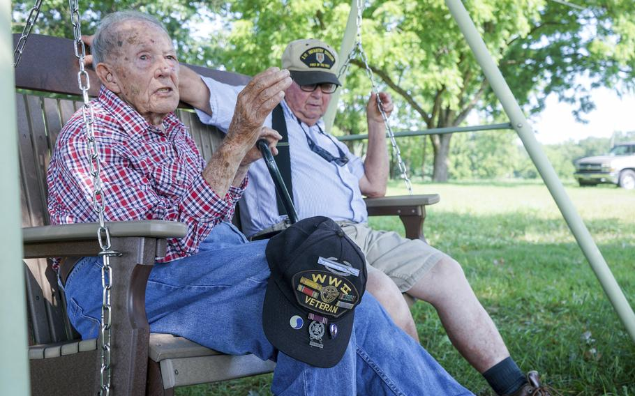 World War II veteran Beverly Salyards, left, sits with Vietnam veteran Larry Ritchie, right, at Ritchie's home in Rockingham County, Va.