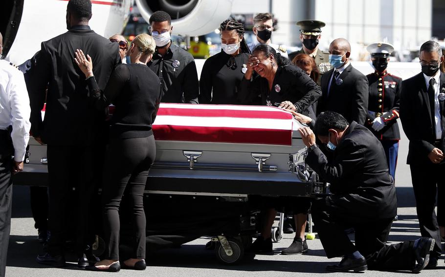 Family members of U.S. Marine Sgt. Johanny Rosario Pichardo are emotional as the casket with Pichardo arrives at Logan Airport on Saturday, Sept. 11, 2021.