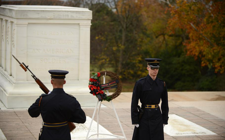 Honor guards patrol the Tomb of the Unknowns at Arlington National Cemetery in Arlington, Va., in 2018.