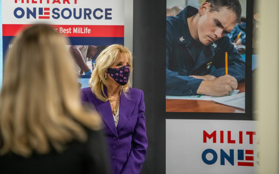 First Lady Jill Biden listens to a facilitator from Military OneSource during a facility tour with Charlene Austin and Hollyanne Milley, in Arlington, Va., April 7, 2021.