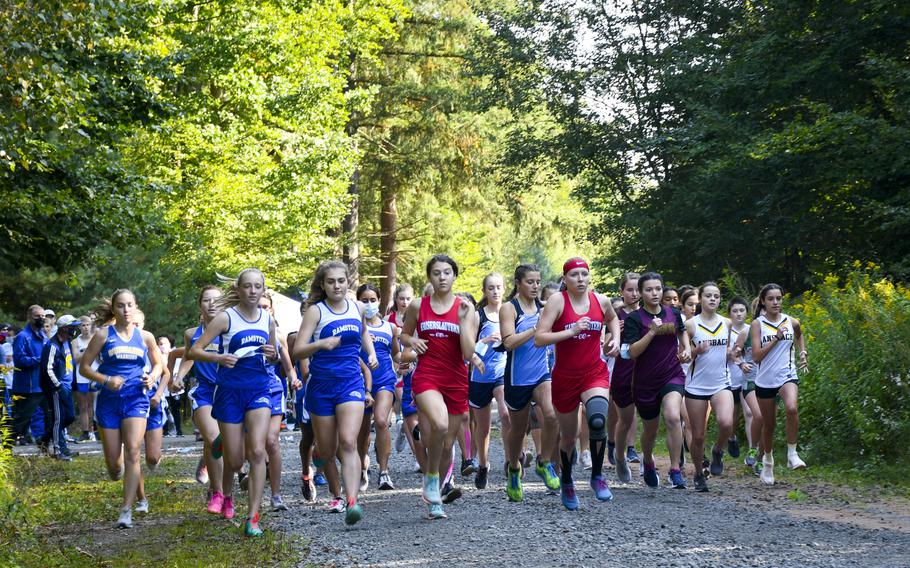 Runners take off at the beginning of a high school girls' varsity cross country race Saturday, Sept. 18, 2021, in Kaiserslautern, Germany.