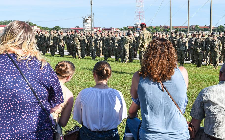 Family members watch their soldiers graduate from the Army's Basic Airborne Course at Fort Benning, Ga. on Friday, May 21, 2021. It marked the first airborne school graduation open to family and loved ones since the beginning of the coronavirus pandemic.
