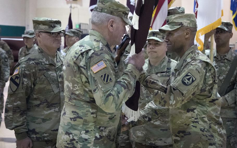 Maj. Gen. Michael Talley, far right, Commanding General of the U.S. Army Medical Research and Development Command (MRDC) and Fort Detrick, Maryland, hands the MRDC unit colors to Gen. John Murray, Commanding General U.S. Army Futures Command, during a Change of Command ceremony, June 22, 2021, at Fort Detrick. Talley relinquished command to Brig. Gen. Anthony McQueen.