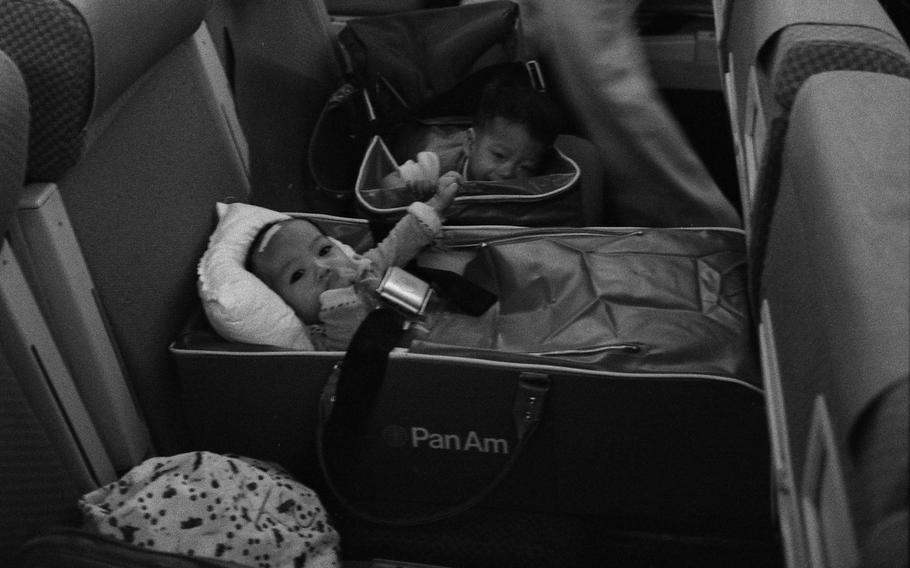 Nurses and Vietnamese refugee children on an Operation Babylift Flight upon arrival at San Francisco International Airport, April 5, 1975.