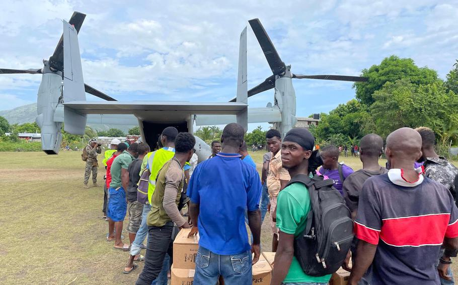 A U.S. military aircraft drops off aid on Friday, August 21, 2021 to Les Anglais, a remote community on Haiti's southern peninsula that was devastated by the August 14, 2021 earthquake.
