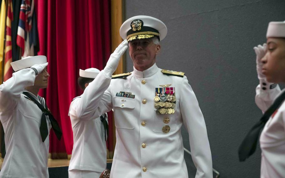 Vice Adm. Karl Thomas salutes after taking command of the 7th Fleet at Yokosuka Naval Base, Japan, Thursday, July 8, 2021.