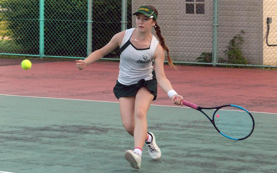Robert D. Edgren's Jenna Mahoney readies a forehand return during Friday's DODEA-Japan tennis matches. Mahoney beat Nile C. Kinnick's Hannah Yi 8-2 and teamed with Caitlyn Carroll to beat Yi and Hannah Nguyen 6-0.