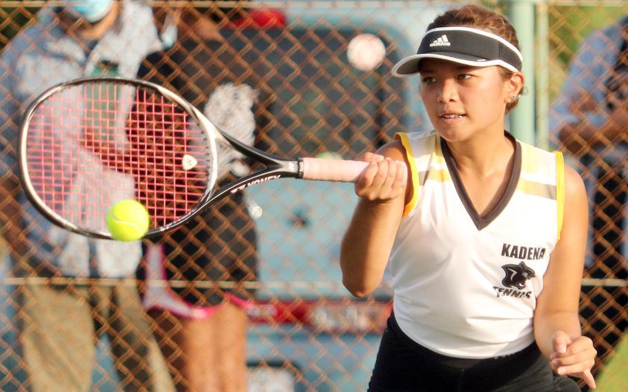 Kadena's Mayann Rivera slaps a forehand return against Kubasaki's Noemi Ung during Wednesday's Okinawa tennis matches. Rivera won 8-2.