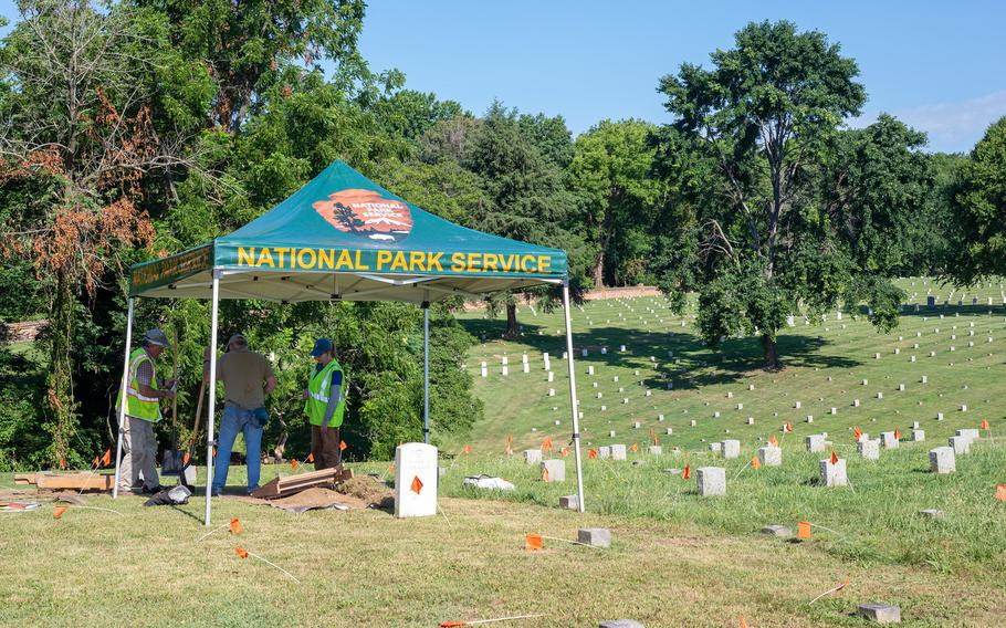 Archaeologists from the Northeast Archeological Resources Program test the proposed location for a new gravesite in the Fredericksburg National Cemetery.