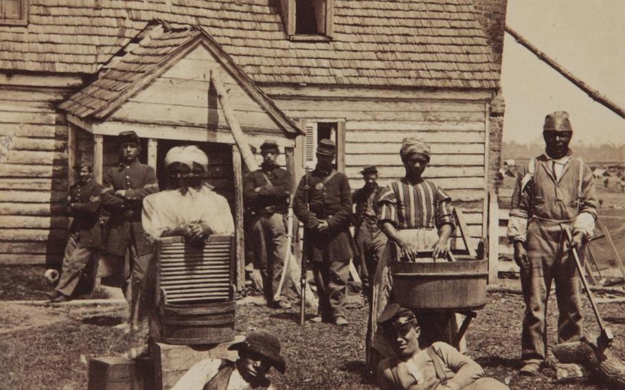 Laundresses with Union soldiers, circa 1863.
