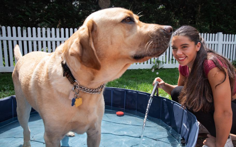Anastasia Pagonis, who lost her vision at age 14, with her service dog, Radar, outside of her home in Garden City, N.Y., on Aug. 10. Pagonis participated in the Paralympics in Tokyo.