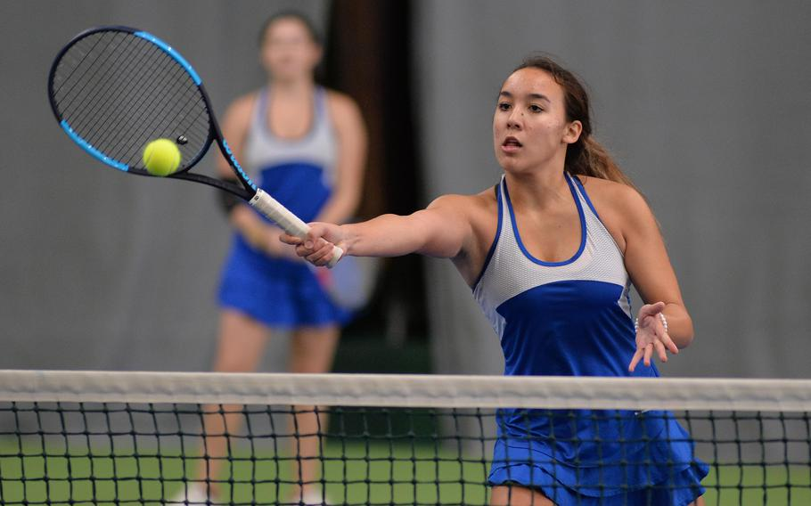 Wiesbaden's Hope Goodwin hits a winner at the net against Ramstein in the girls doubles final at the 2019 DODEA-Europe tennis championships in Wiesbaden, Germany.  Goodwin will return for the Warriors when the 2021 tennis season gets underway.