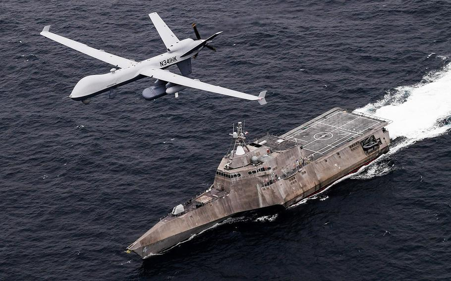 An MQ-9 Sea Guardian unmanned maritime surveillance aircraft system flies over Independence-variant littoral combat ship USS Coronado during U.S. Pacific Fleet's Unmanned Systems Integrated Battle Problem 21 on April 21, 2021.