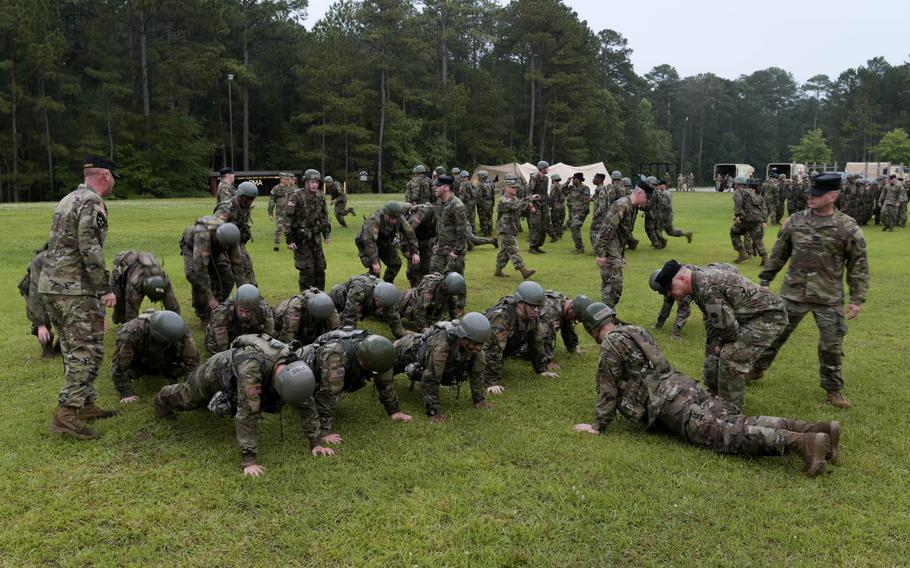 U.S. Army National Guard Soldiers perform push-ups during Phase 1 of Officer Candidate School conducted by 2nd Battalion (OCS), 218th Regional Training Institute, South Carolina National Guard, at McCrady Training Center in Eastover, S.C., June 5, 2021.