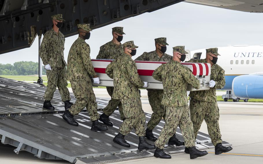 A Navy carry team transfers the remains of Navy Hospital Corpsman Maxton W. Soviak of Berlin Heights, Ohio, on Aug. 29, 2021, at Dover Air Force Base, Del. Soviak was assigned to the 1st Marine Regiment, 1st Marine Division, Camp Pendleton, Calif.