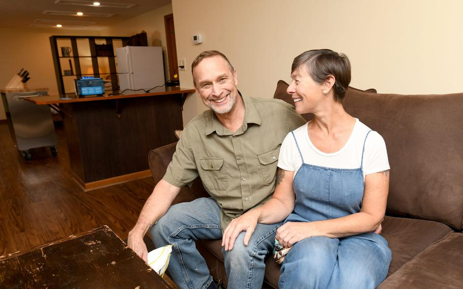Ken and Angel Perkins of North Canton are seated in one of the two apartments they plan to offer to Afghan refugees in need of temporary housing. Angel Perkins is a retired nurse and chef. Ken Perkins is retired from the U.S. Air Force.