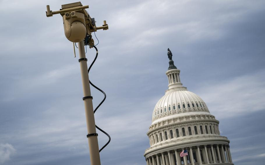Workers set up surveillance equipment outside the U.S. Capitol.