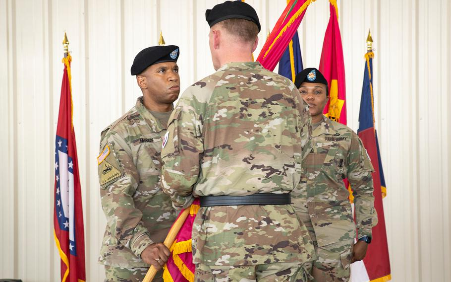 Colonel Eric A. McCoy accepts the colors from  MG Darren L. Werner, commanding general of the U.S. Army Tank-automotive and Armaments Command, during the Change of Command ceremony on July 29, 2021 at Anniston Army Depot.