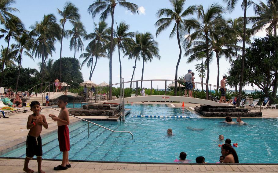 Pools at the Hale Koa Hotel beckon service members and their families enjoying the Hawaiian sunshine along the shores of Waikiki Beach. Because of the coronavirus pandemic, the Air Force is letting members accrue up to two months of extra leave to use over the next three years.