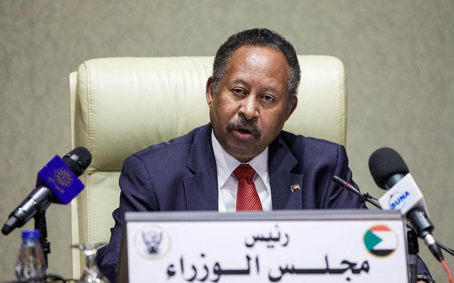Sudan's Prime Minister Abdalla Hamdok chairs a Cabinet meeting in the capital Khartoum on Tuesday, Sept. 21, 2021.