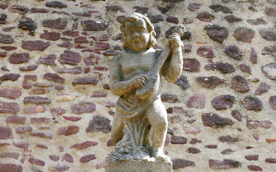 This little musician tops a fountain in what was the moat surrounding Burg Hayn, Dreieichenhain, Germany's medieval castle.