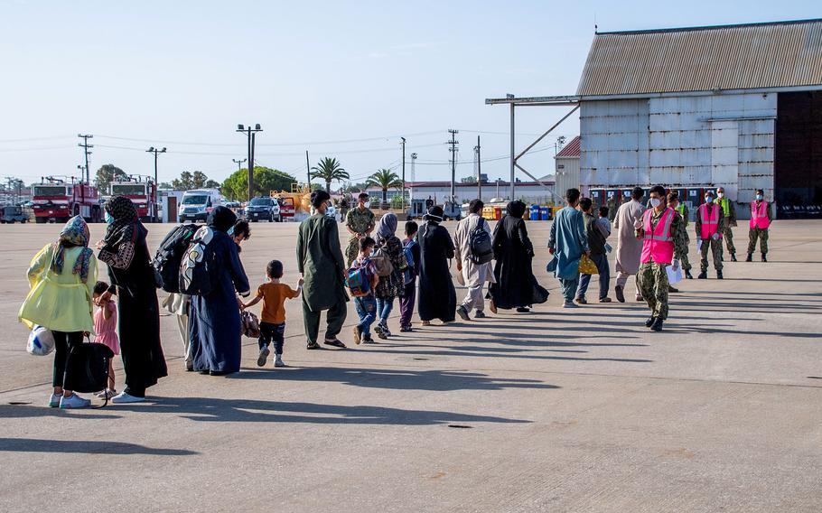 Evacuees from Afghanistan arrive at Naval Station Rota, Spain, on Friday, Aug. 27, 2021.