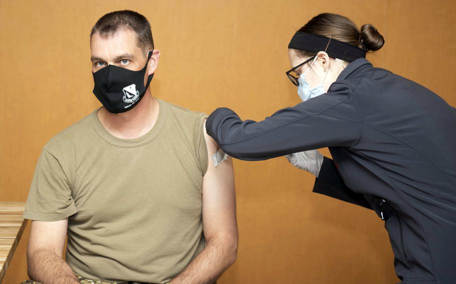 Col. Andrew Campbell, 374th Airlift Wing commander, receives the Moderna COVID-19 vaccine at Yokota Air Base, Japan, Jan. 12, 2021.