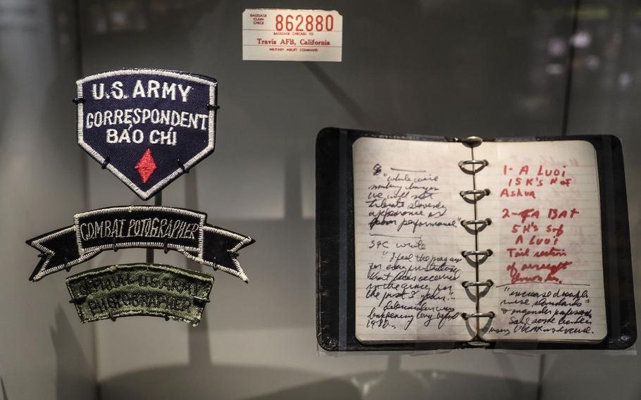 Combat journalists' patches and notebook at the National Museum of the United States Army on its reopening day, June 14, 2021.