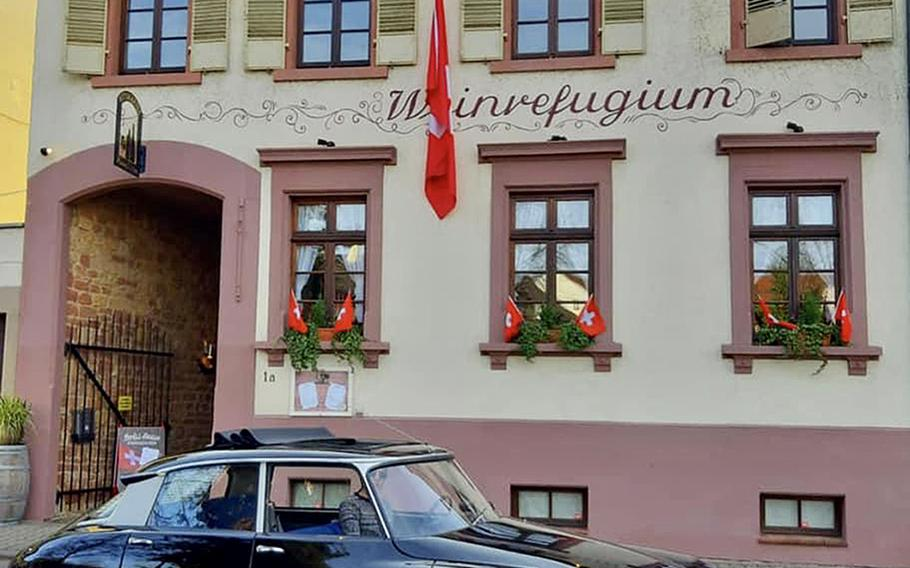 The Swiss House restaurant is located in an old residential building in Bad Duerkheim, Germany. It has outside seating in an enclosed garden, in addition to the Alpine-style interior rooms.