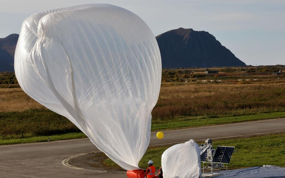 An electronics and engineering team from Raven Aerostar launches a high altitude balloon from Andoya Air Station to sense a simulated target in the Norwegian Sea during the Thunder Cloud live-fire exercise in Andoya, Norway, Sept. 15, 2021. Three high altitude balloons were launched into the stratosphere and relayed data to project coordinates for soldiers firing precision artillery.