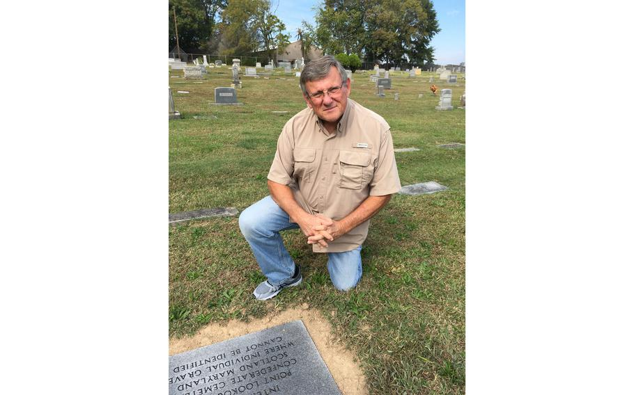 Gary Holland at the granite marker in Gastonia's Hollywood Cemetery, which marks the service of his great-great-great grandfather William Taylor Ingram.