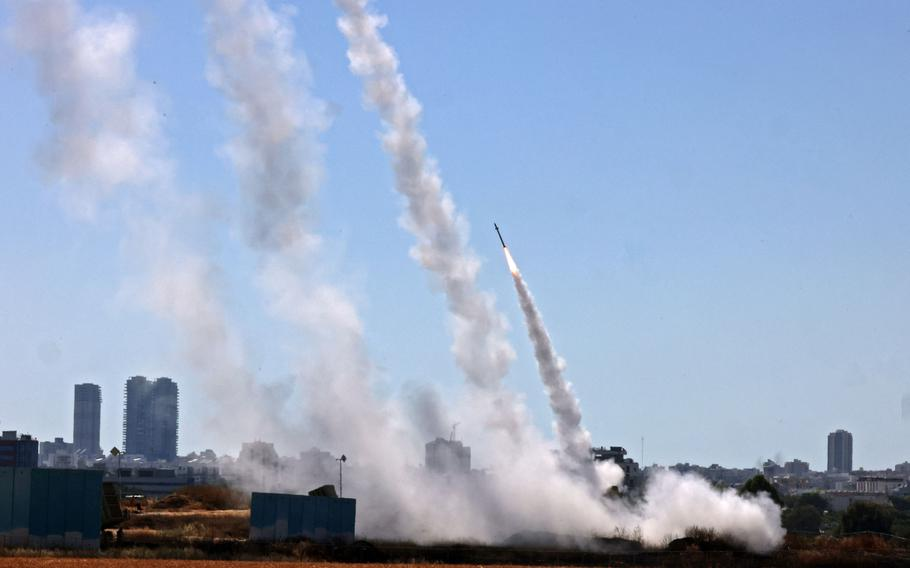 Israel's Iron Dome aerial defense system is activated to intercept a rocket launched from the Gaza Strip, controlled by the Palestinian Hamas movement, above the southern Israeli city of Ashdod, on May 12, 2021.