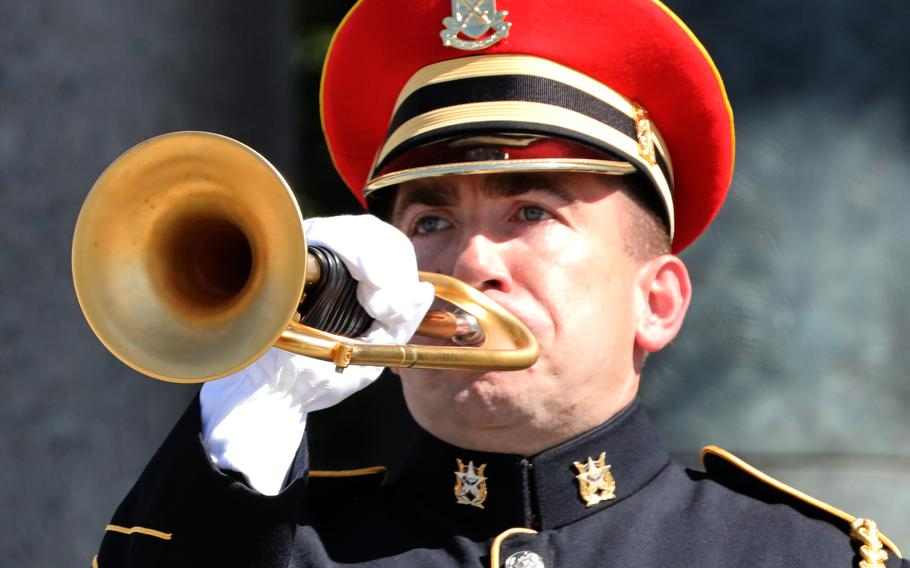 """The bugler at Monday's Memorial Day ceremony at the National World War II Memorial in Washington, D.C. set the tome for musicians across the country who would take part in """"Taps Across America"""" later in the day."""