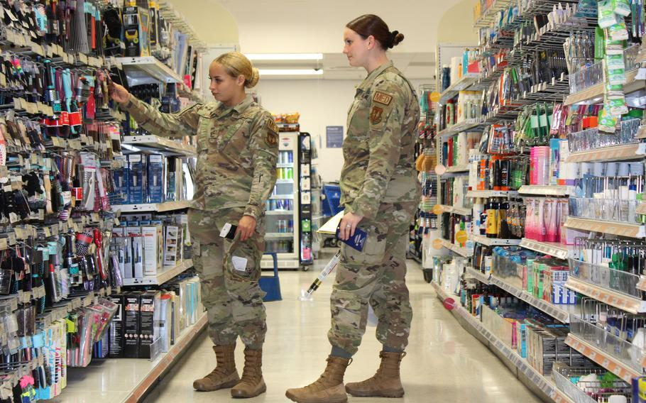 Air Force members shop at the exchange at RAF Lakenheath, England July 19, 2021, under guidelines that allow fully vaccinated service members to go without masks in base facilities, with some exceptions.