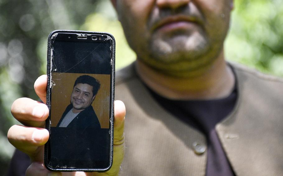 Afghan journalist Zainullah Stanikzai keeps photos on his phone of Aliyas Dayee, his friend and a fellow reporter, who was killed Nov. 12, 2020 in southern Helmand province when a bomb attached to his car detonated. Stanikzai said on Aug. 2, 2021 that he hopes to come to America through a program to allow those who worked for U.S. media companies and are under threat to receive a visa.