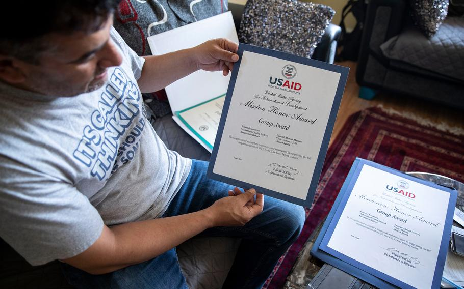 Sadiq Sadeed shows some of the awards he received from USAID, the development agency, at his home in the Mayfair section of Philadelphia. He was translator at USAID in the U.S. Embassy in Kabul, Afghanistan.