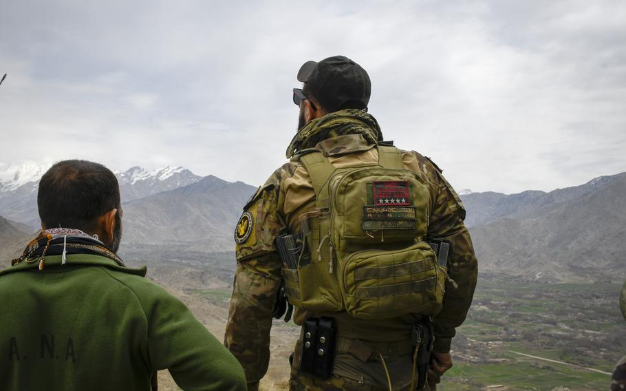 Maj. Sohrab Azimi, a U.S.-trained Afghan commando, looks over a valley in Kapisa province in Afghanistan on March 6, 2021. Azimi was one of at least 21 Afghan special forces troops who were killed in an operation in Faryab province on June 16, 2021.