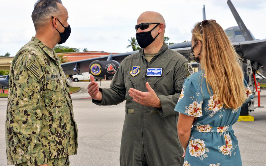In a Feb. 13, 2021 photo, U.S. Navy Rear Adm. John Menoni, Joint Region Marianas commander, left, speaks with U.S. Air Force Col. Joseph Sheffield, 36th Operations Group commander, and his spouse, Sarah Sheffield, during an Exercise Cope North aircraft static display at Andersen Air Force Base, Guam.