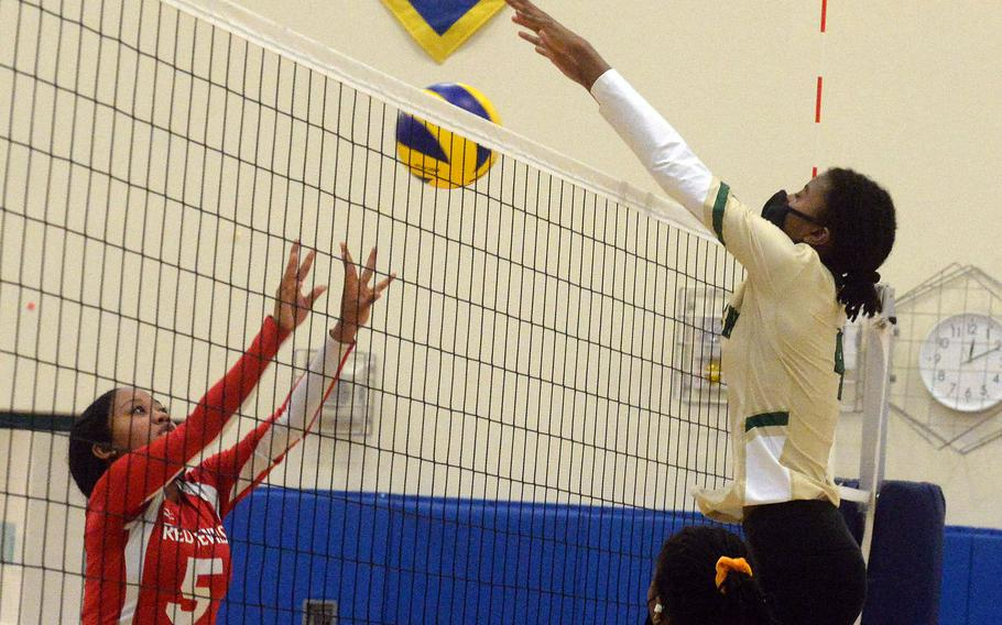 Nile C. Kinnick's Angelica Rodgers has her shot blocked by Robert D. Edgren's Elizabeth Johnson during Saturday's Japan girls volleyball match. The Eagles won in straight sets to improve to 10-0 on the season without dropping a set.