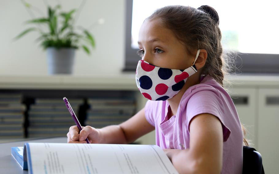 A student at Vogelweh Elementary School listens during a lesson in April 2020.