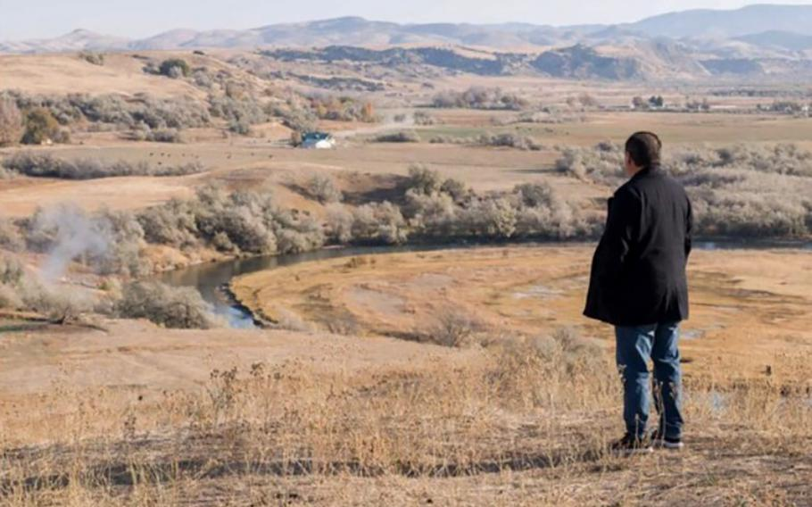 Darren Parry, the grandson of Mae T. Parry, looks out over the site where ancestors from his tribe — the Northwestern Band of the Shoshone Nation — were massacred in 1863 by the U.S. Army. Parry has been working to get more recognition for the site and helping on plans to build a facility that would honor those who were killed.