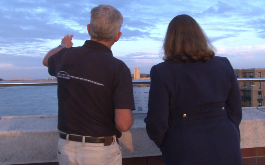 Retired Royal Dutch Air Force Lt. Col. Tim Ruijling, left, points out bridges east of the Oversteek Bridge in Nijmegen, the Netherlands, to U.S. Embassy charge d'affaires and acting ambassador Marja Verloop, on Friday, Aug. 13, 2021, ahead of the 2,491st Sunset March.