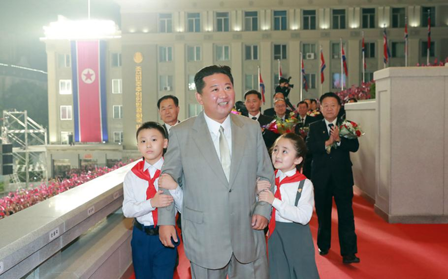This image from the state-run Rodong Sinmun newspaper shows North Korean leader Kim Jong Un attending a military parade in Pyongyang, early Thursday, Sept. 9, 2021.