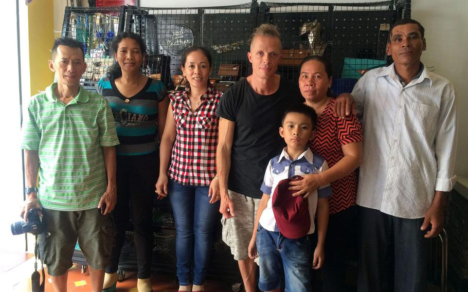 Brian Hjort, center, poses in this undated photo with a family he reunited in Vietnam. Since the early 1990s, Hjort has been using DNA analysis programs and databases to help people find their long-lost relatives.