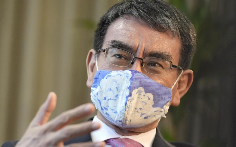 In this July 28, 2021, file photo, Taro Kono, Japan's minister in charge of a huge vaccination campaign, speaks during an interview with The Associated Press at his office in Tokyo.