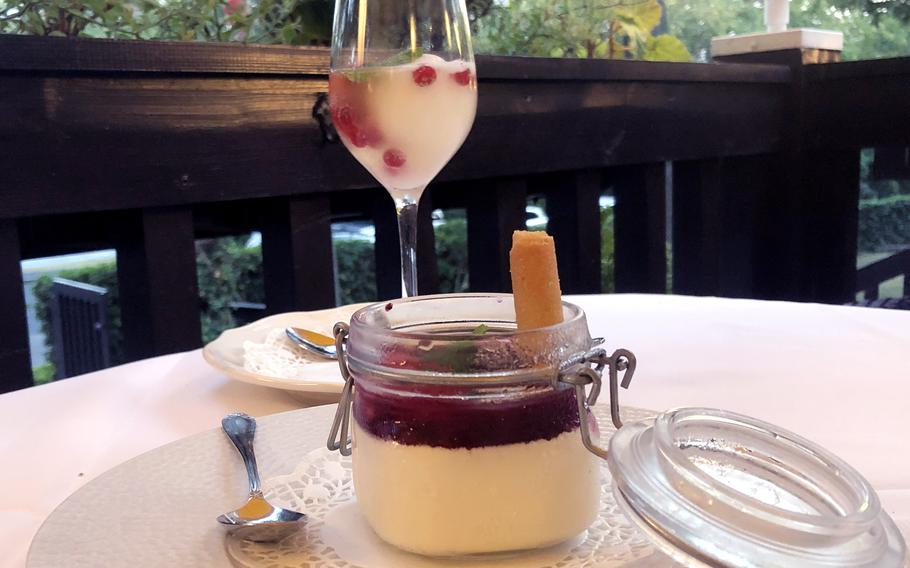 """Our desert to end a delicious meal at Forsthaus Rheinblick in Wiesbaden, Germany, was """"tipsy"""" lemon sorbet topped up with fresh berries and a dash of Rheingau Riesling sparkling wine, rear, and homemade panna cotta topped with wild berries."""