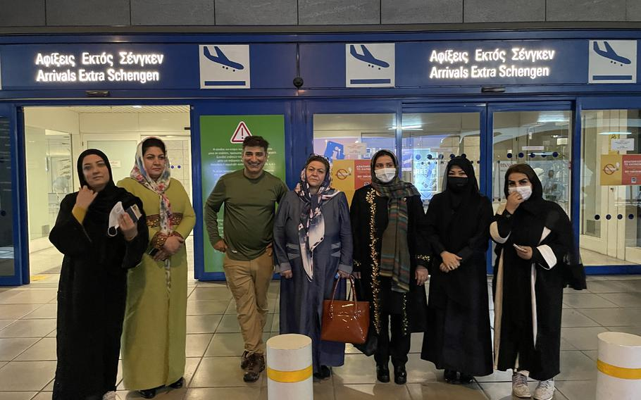Amed Khan, a New York-based philanthropist, center, stands in Athens airport with female lawmakers he helped escape Afghanistan.