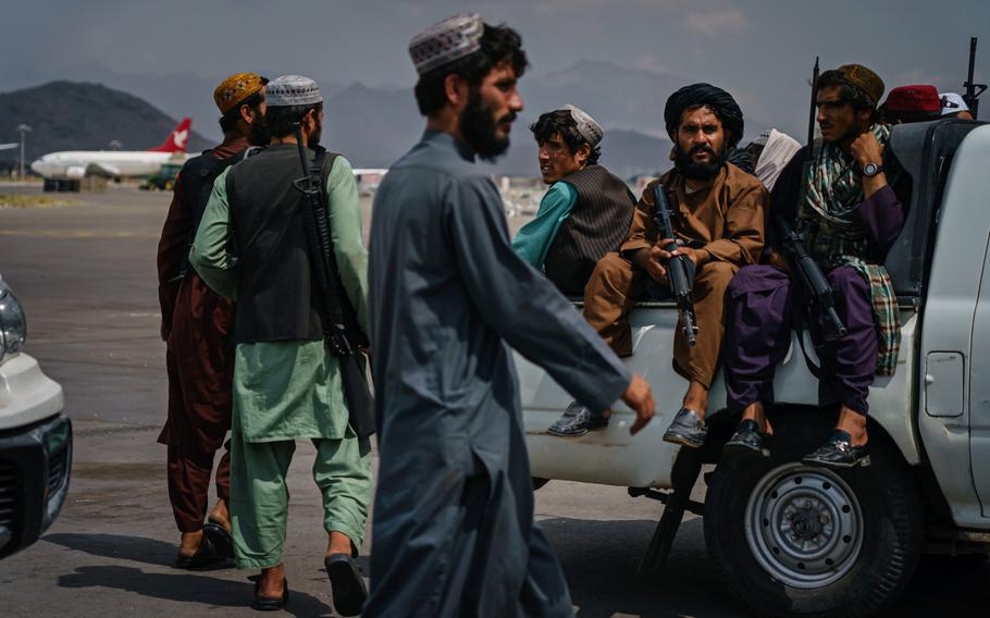 Taliban fighters patrol the tarmac after the United States Military have completely withdrawn from the country and Taliban fighters moved in to take control of Hamid Karzai International Airport, in Kabul, Afghanistan, Aug. 31, 2021.