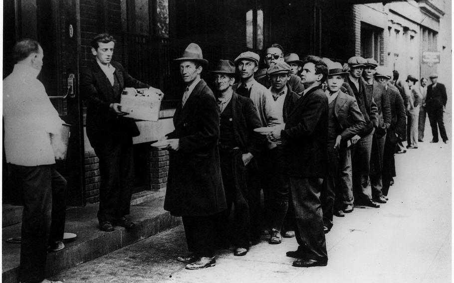 A long line of people waiting to be fed in New York City during the Great Depression.