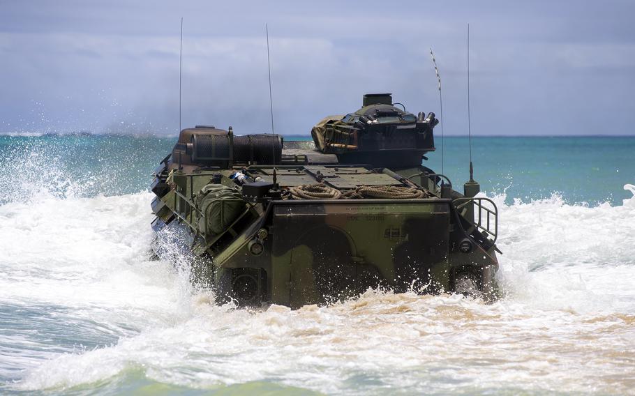 Marines from Company B, 3rd Assault Amphibian Battalion train in an assault amphibious vehicle at Camp Schwab, Okinawa, June 2, 2021.